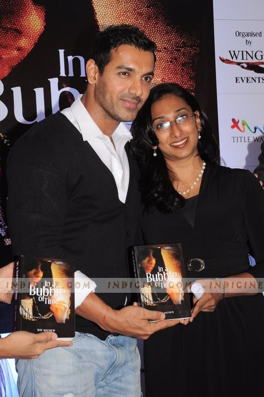 John Abraham with his sister Susy Matthew at her book 'In a Bubble Of Time' launch