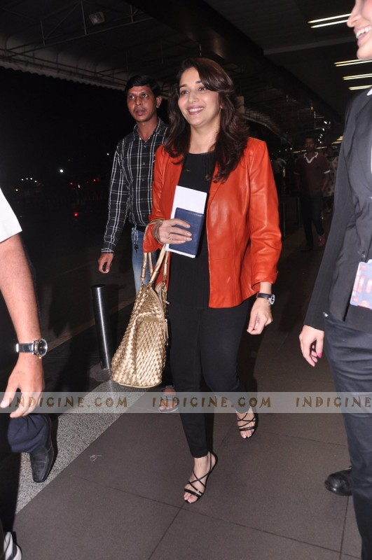 Madhuri Dixit leaves for IIFA Awards 2013