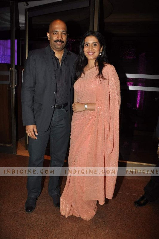 Sonali Kulkarni with husband Nachiket Pantvaidya at Sunidhi Chauhan's wedding ceremony