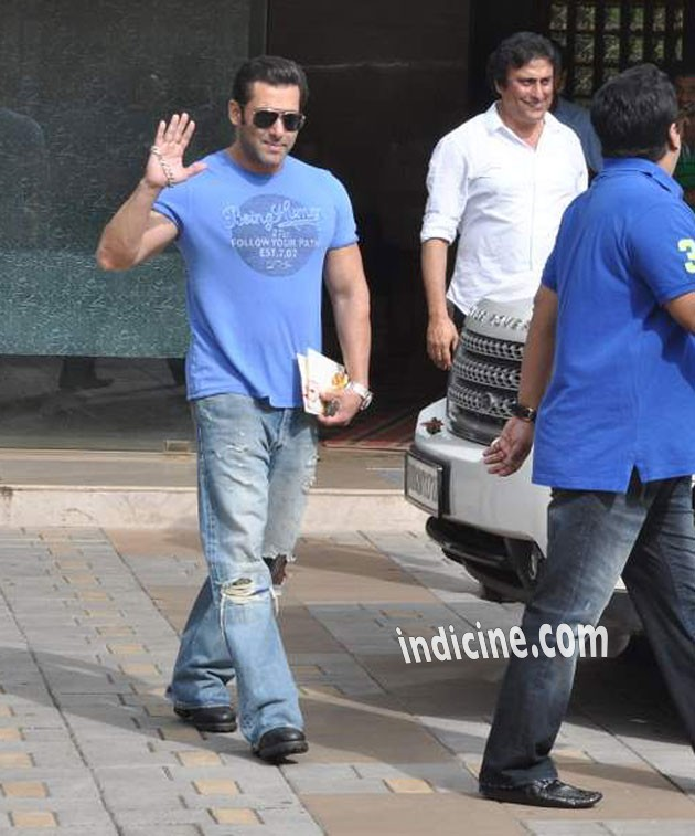Salman Khan waves to the media outside his home