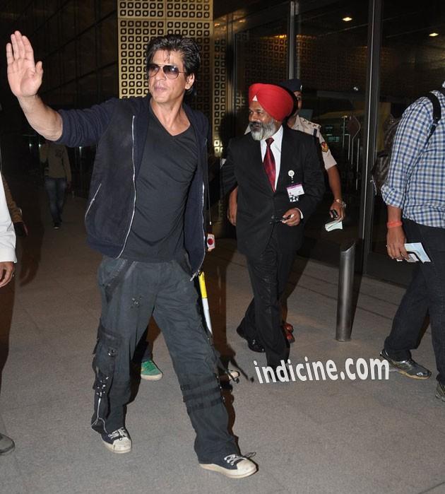 Shah Rukh Khan waves to media