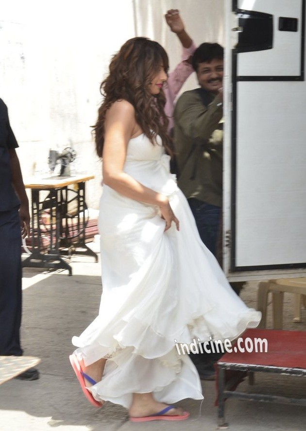 Bipasha Basu is wearing a white strapless dress at Filmistan