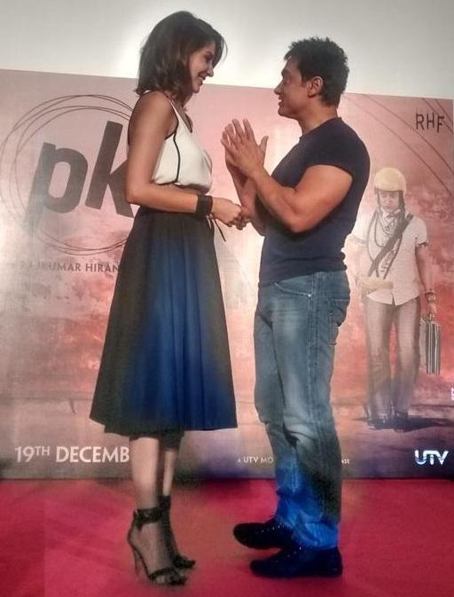 Anushka Sharma and Aamir Khan during the PK teaser launch