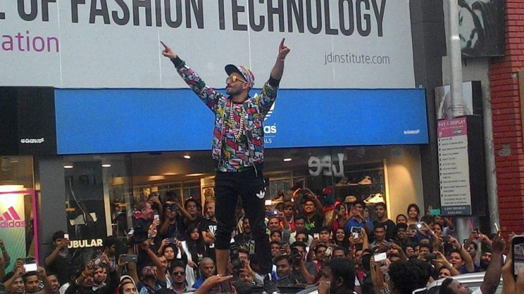 Ranveer standing on a car at the Brigade Road in Bangalore