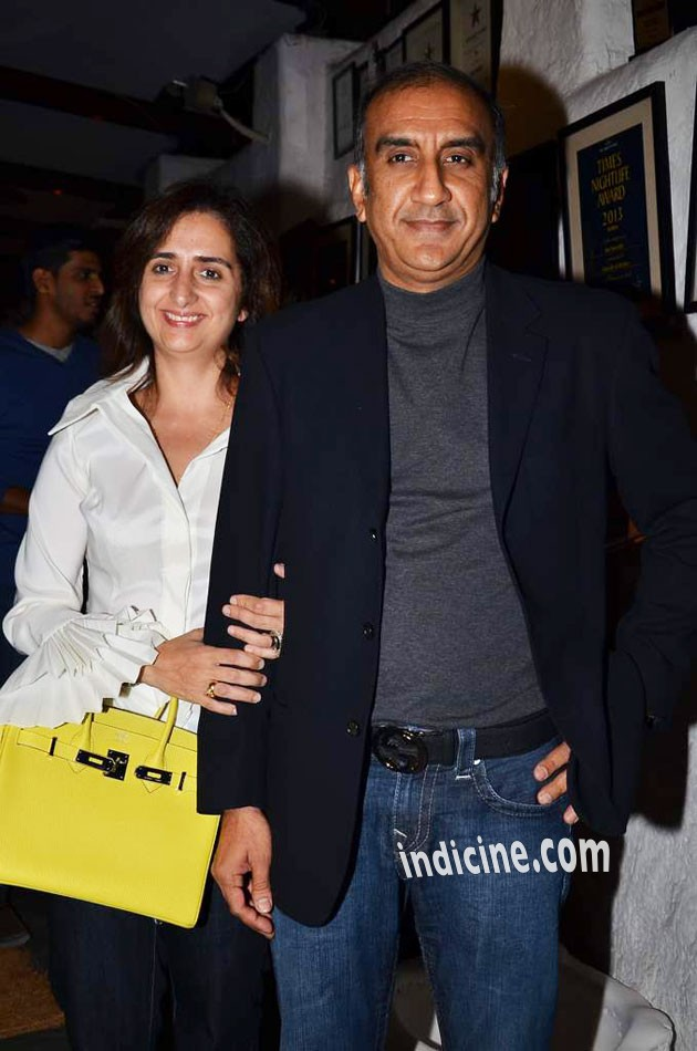 Milan Luthria with wife