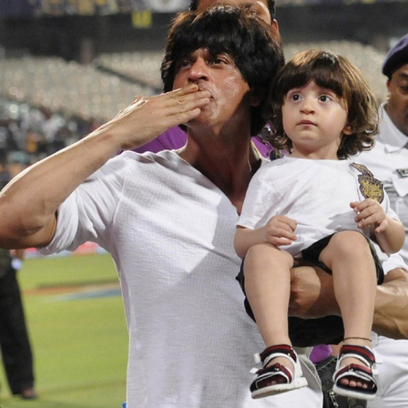 SRK with his little son AbRam waving to the crowd after his team's victory